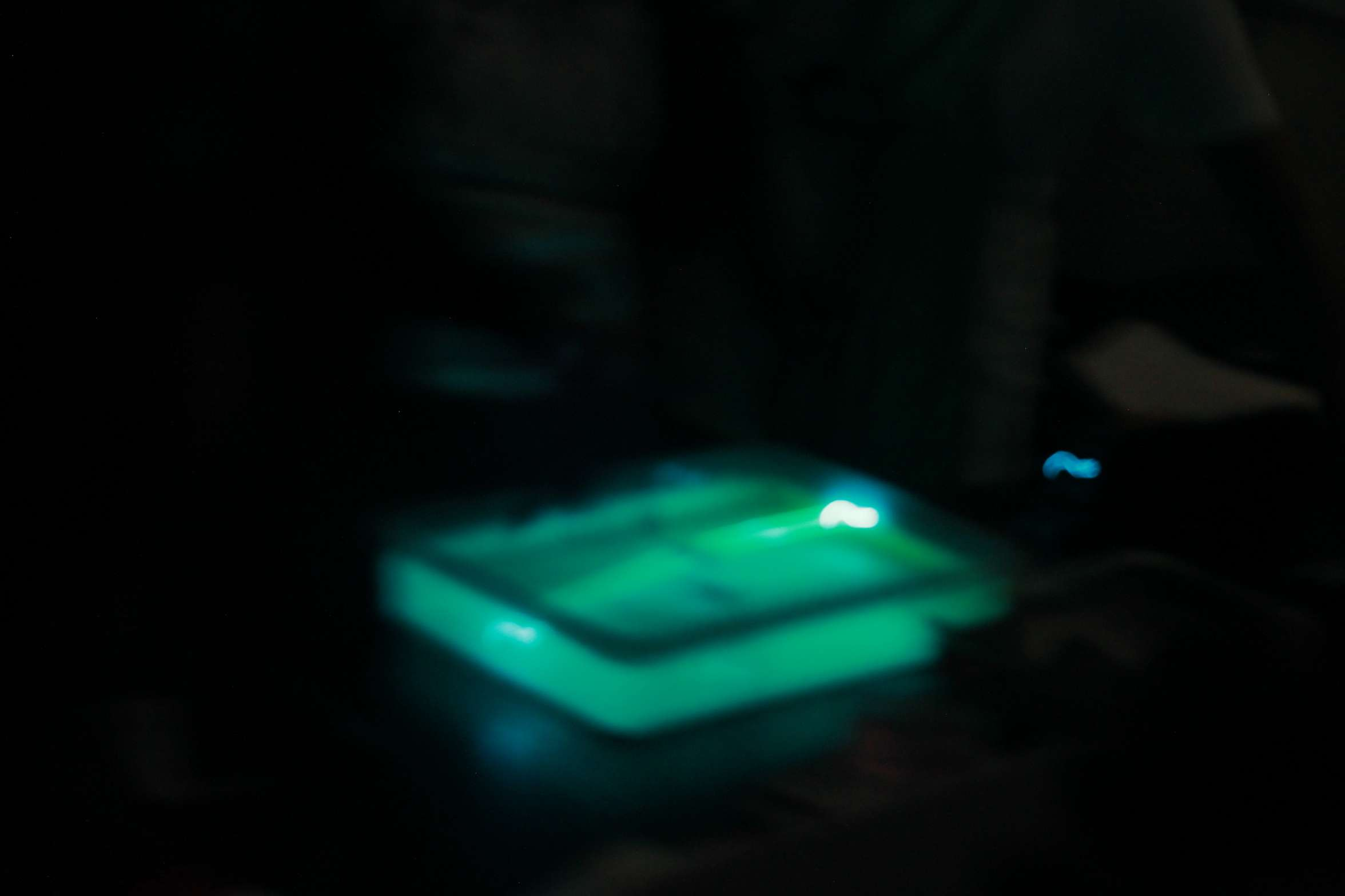 NCBS Open Day: Blurry picture of fluorescence in the live microscopy explainer room.